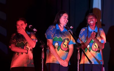 Girls laughing and singing at Outback Festival 2017.