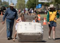 Girls rolling wool bale at Outback Festival