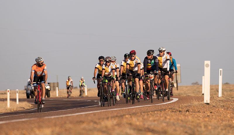 Outback century cycle riders on the road.