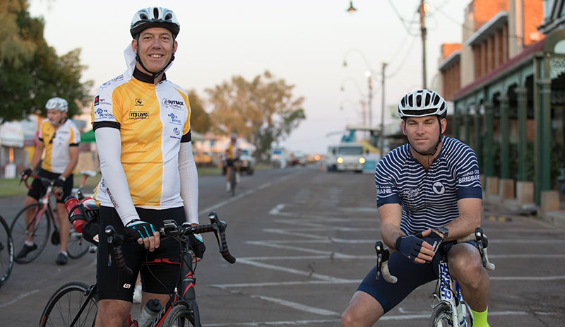 Two men waiting for Outback Century Cycle competition to begin at Outback Festival