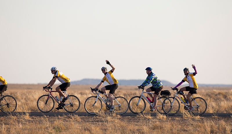 Outback century cycle races waving.