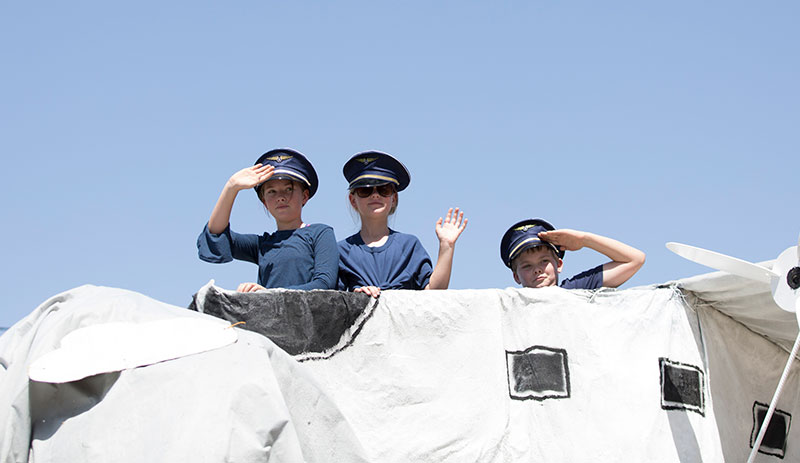 Kids saluting in the Grand Parade