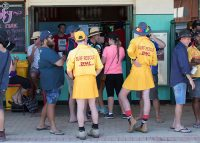 Surf Lifesavers waiting for a drink at True Blue Outback Aussie Sports Pub Crawl
