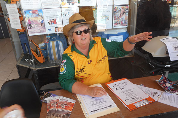 Volunteer giving directions at Outback Festival