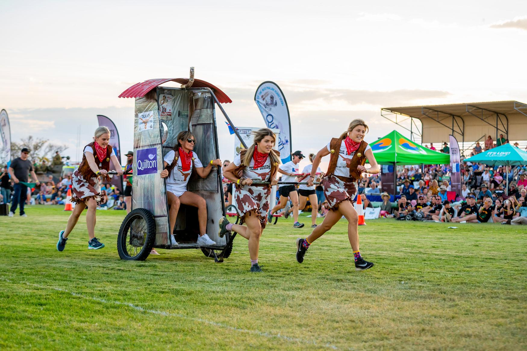 Dunny Derby cowgirls running