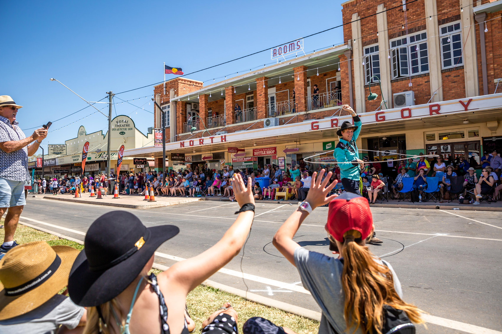 guests waving at entertainer in grand parade