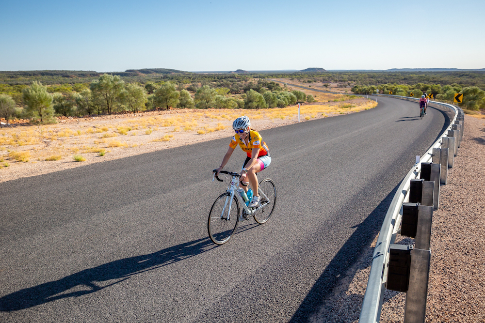 Solo bike rider on outback road