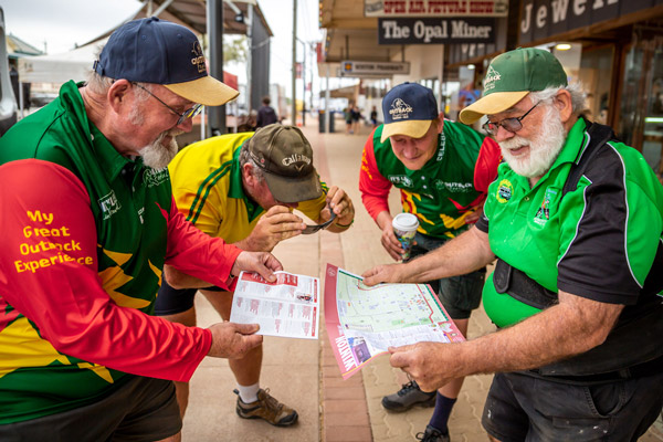 volunteers looking at site map for outback festival